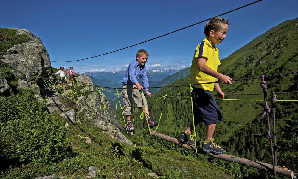 Action and adventures during a farm holiday with children in South Tyrol